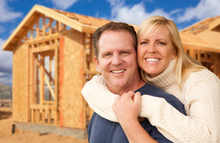 Photo of couple building new home