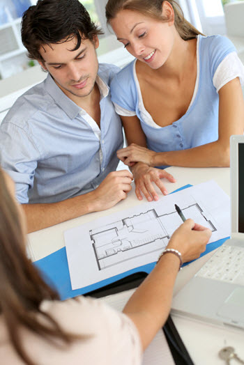 Photo of couple buying a new house